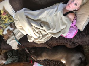 Laura Schreiber on Sofa with Her Dogs